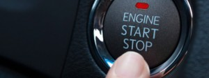 detail of a finger pushing start engine button