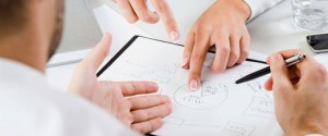 man and woman analysing charts