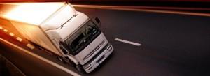 white truck travelling, sunset