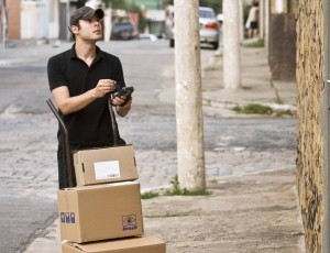 man delivering packages with a device on the hand