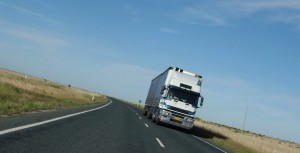 withe truck travelling on the road