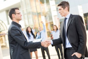 two mens shaking hands become a member